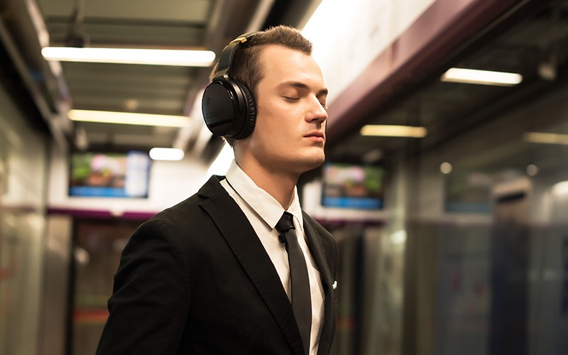 Young man wearing noise-cancelling headphones at the office