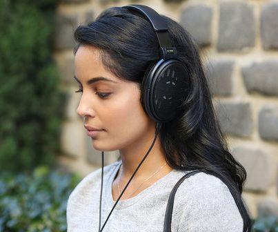Young girl wearing open-back headphones