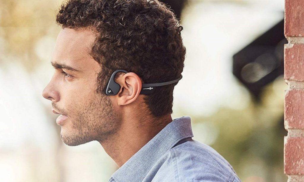 Man wearing bone conduction headphones