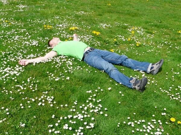Man on a grass field during one of his dreams