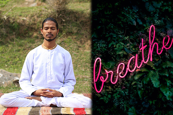 Asian yogi doing breathing exercises (pranayama) as part of his morning routine.