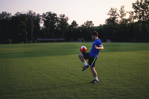 Man chasing a good fitness goal: improving football skills