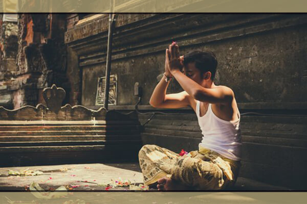 Pray: natal yogi practicing his morning routine