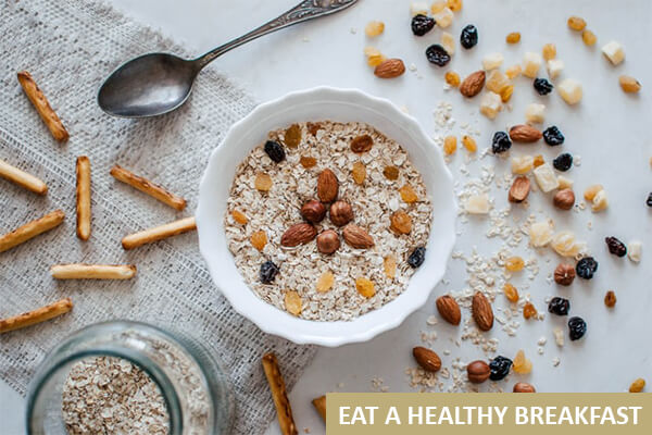 A bowl of oatmeal with nuts and seeds that a yogi would prefer for breakfast during their morning routine